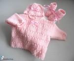 Trousseau bb fille coloris rose en calinou, tricoté main